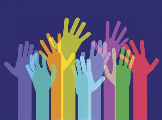 picture of hands in the air as a symbol of volunteering