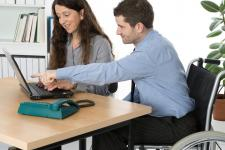 photos of man and woman working on a computer