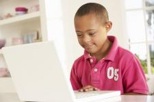 photo of a young student on a laptop